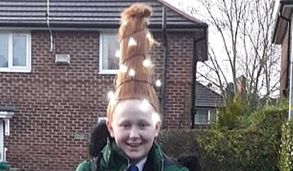 Teenager fashion hair into a Christmas tree complete with fairy lights