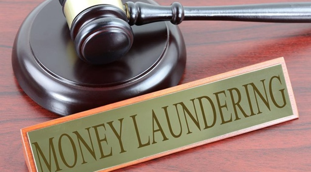 Eleven charged with money laundering