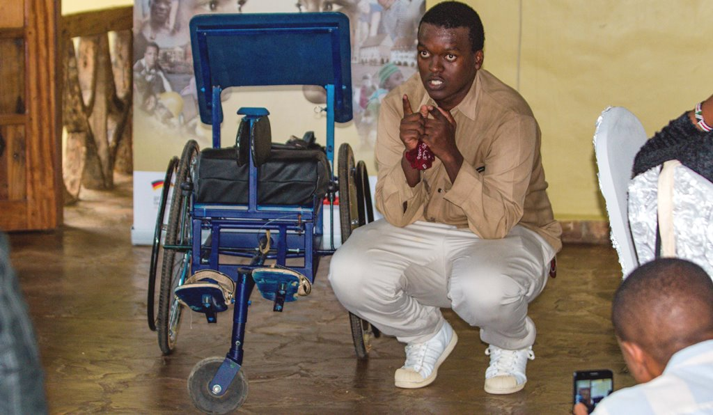 Locally made wheelchair for impaired children