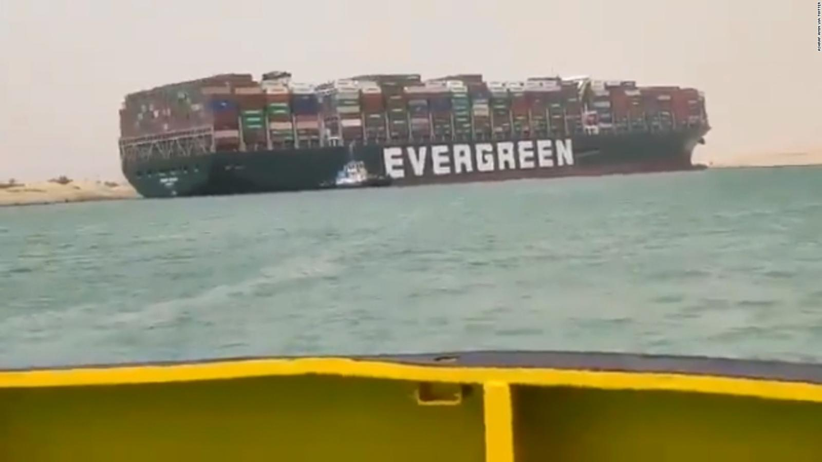 Dislodging huge ship stuck in Suez Canal at crucial stage